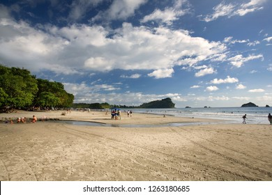 Tourists having fun at Manuel Antonio Beach, Costa Rica, in Afternoon