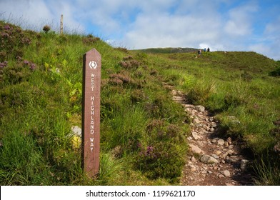 Tourists hiking on West Highland Way in Scotland