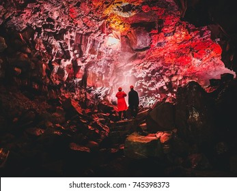 Tourists Inside the magnificent lava tunnel Raufarholshellir close to Reykjavik, Iceland
