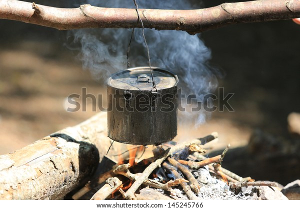 tourists kettle on campfire