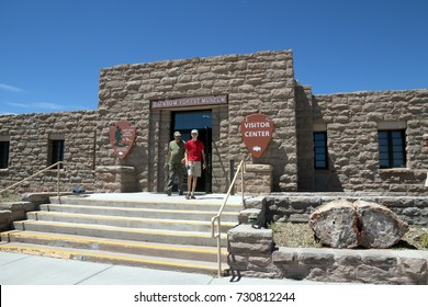 Tourists leave the building of the visitor center and Rainbow Forest Museum of the Petrified Forest.  National Park in Arizona. US