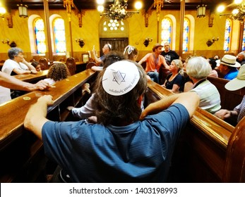 Tourists listen to tour guid explain about The Great Synagogue, Dohany Street Synagogue, in Budapest in Hungary, it is the largest Judaism Temple in Europe, and a centre ofNeolog Judaism. 2017-6