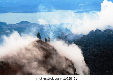 The Tourists look at the Pacific ocean with of the volcano. Kamchatka.