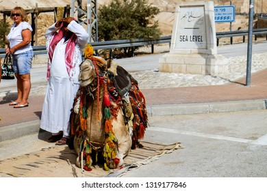 "Tourists are looking at the camel at the ""Sea Level Point"" near Jericho, Israel. The Dead Sea is the lowest place on earth. 13-09-2015"