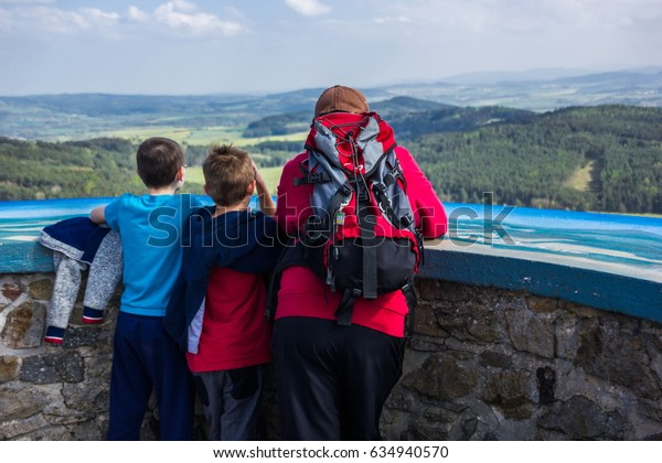 Tourists looking at Czech landscape