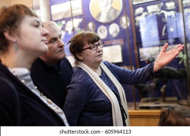 Tourists looking at exhibit at the exhibition
