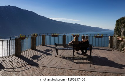 tourists are looking the Lake Garda from Tremosine