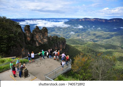 Tourists are looking at Three Sisters - Blue Mountain view point in blue sky day, Sydney, New South Wales, Australia on April 7, 2013