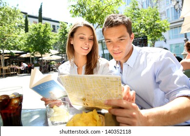 Tourists in Madrid reading city map