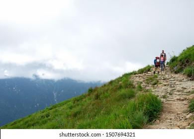 The tourists mountaineer trekking on the top of Karamatsu mount in summer season at Hakuba city, Nagano prefecture, Japan on 14 August 2019 at 11.50 am.