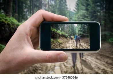 Tourists in the mountains, a man walks along a mountain path forest, high in the mountains, phone in hand man (photographing the landscape) photos from your phone, Self, photographing on the phone,