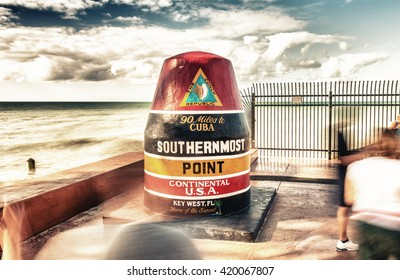 Tourists moving along Southernmost Point, Key West - Florida.