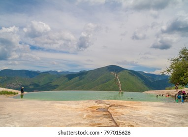 tourists at the natural pools of Hierve el Agua park, in Oaxaca, Mexico