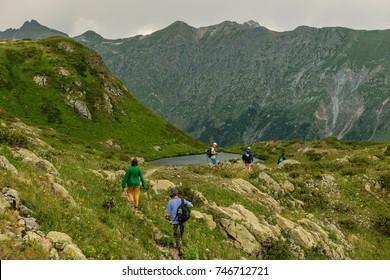 Tourists near mountain lake, Abkhazia