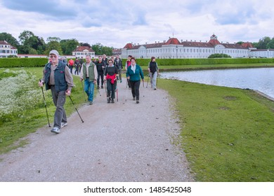 Tourists at The Nymphenburg Palace, designed by Agostino Barelli in 1664. Their rooms show their original baroque decoration and neoclassical style. Munich. German. 05/2014.