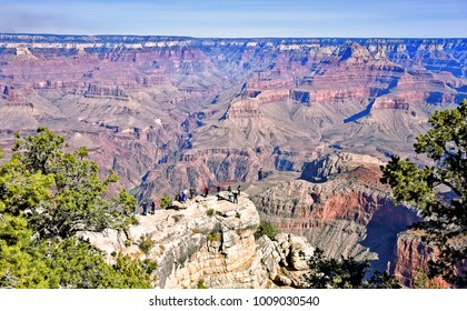 Tourists observing canyon's scenic landscape from South Rim. Grand Canyon National Park (UNESCO World Heritage Site) - one of most popular tourist destination in USA. Photo taken 2017-11-21.