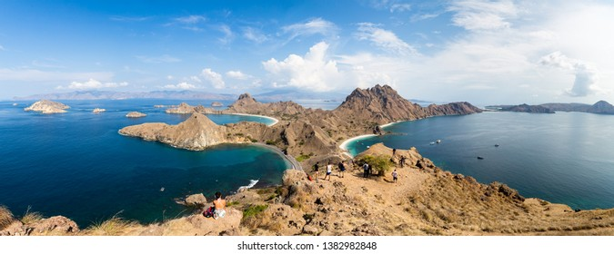 Tourists observing the Panoramic view from the top of Padar Island in Komodo National park in autumn, a protected area which is a paradise for diving, Lubuan Bajo, Flores, Nusa Tenggara, Indonesia