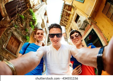 tourists in the old town. couple tourists walking in the old town of Chania and take funny selfie on a wide angle