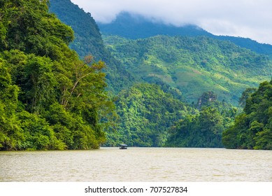 Tourists on the boat are going to enjoy beautiful natural scenery Ba Be Lake. Beautiful scenery of Ba Be National Park, Bac Kan province, Vietnam.