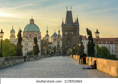 Tourists on the Charles Bridge in the early morning in Prague, Czech Republic - June 2017