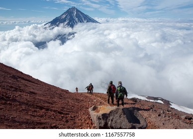tourists on the descent from the volcano
