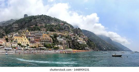 Tourists on famous Positano beach coast during summer