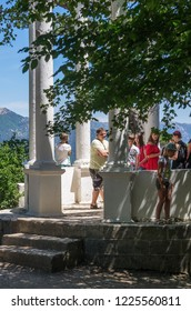 Tourists on the observation deck in the mountains. Russia, Republic of Crimea. 06/13/2018: Silver arbor on the top of Pendicul mountain, on the way to Ai-Petri
