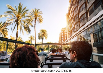 Tourists on open top sightseeing bus Hop on hop off in Valencia explore city