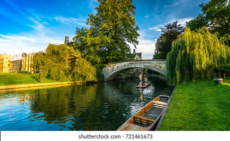 Tourists on punt trip (sightseeing with boat) along River Cam near Kings College in the city of Cambridge, United Kingdom