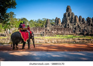 Tourists on an ride elephant tour of Bayon temple in Angkor Thom,landmark in Siem Reap, Cambodia.