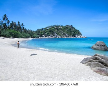 Tourists on the sand of remote haad tien beach on Koh Phangan island in the gulf of thailand