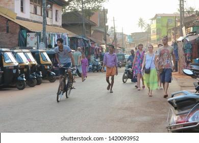 Tourists on the streets of Gokarna, India. February 13, 2019