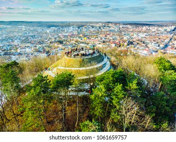 tourists on top of hill. high castle in lviv. birds eye view