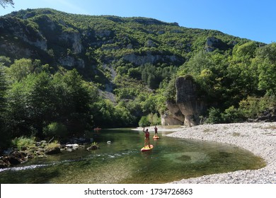 Tourists paddling on the river of Gorges du Tarn in France