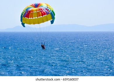 Tourists parasailing on aegean sea in Kusadasi, Turkey