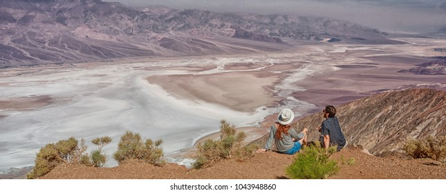 tourists people enjoying view desert landscape of Badwater in Death Valley National Park, California, USA.
