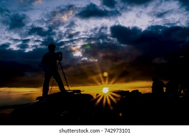 tourists to photograph. Sunrise silhouette art.
