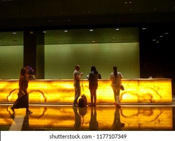 Tourists at the reception check into the hotel Rixos Premium. Dubai. September 2018