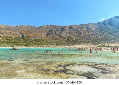 Tourists relax and bathe in crystal clear azure water of the famous Bay of Balos.Seascape.District of Chania.Crete island.Greece.Europe.