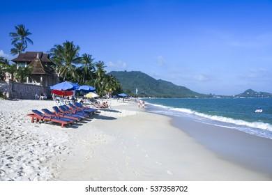 tourists relaxing on the popular lamai beach ko samui island thailand