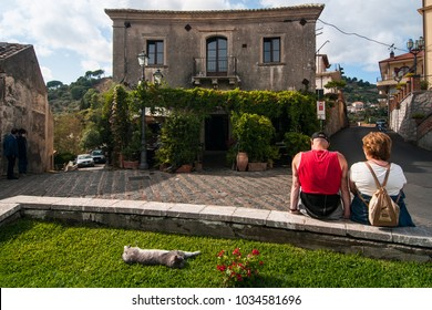 Tourists rest in front of Bar Vitelli in the village of Savoca, Sicily, Italy. The town was the location for the scenes set in Corleone of Francis Ford Coppola's The Godfather.
