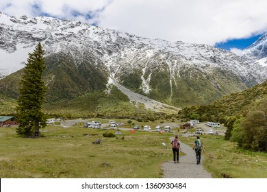 Tourists are returning to the base camp after walking along the Hooker Valley Track