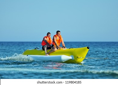 Tourists ride a Banana Boat