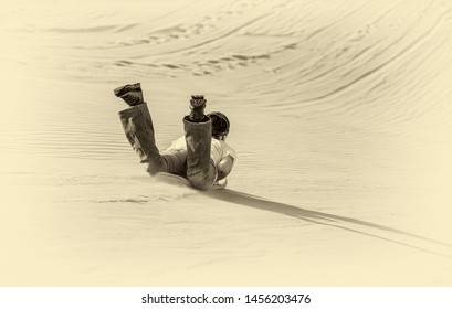 Tourists ride the sandboards from the tops of the dunes near the Huacacina oasis (stylized retro)