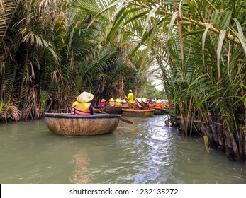 Tourists riding bamboo basket boats in Hoi An,vietnam