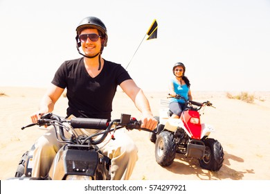 Tourists Riding Quad Bikes