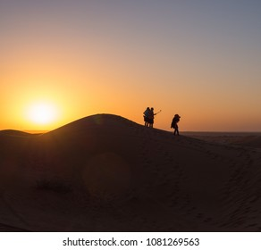 Tourists in Safari desert taking selfie and  enjoying sunset view near Dubai, UAE