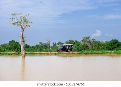 Tourists in safari vehicle in national nature park Udawalave