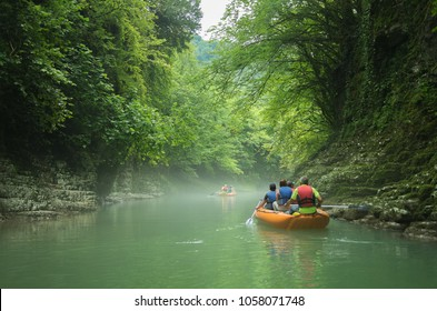 Tourists sail on a rubber boat along the canyon. Georgia