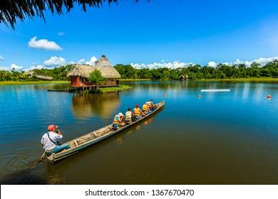 Tourists sailing in a canoe over Lake Miracle. Sunday, June 7, 2015, Tingo Maria, Peru